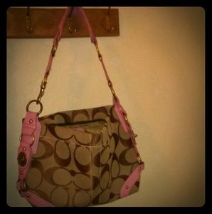 Coach purse in colors pink and brown